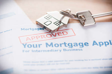 loan: Approved Mortgage loan application with house key