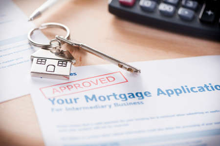 home loans: Approved Mortgage loan application with house key