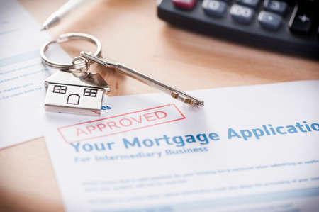 richiesta di prestito ipotecario approvato con chiave di casa Archivio Fotografico