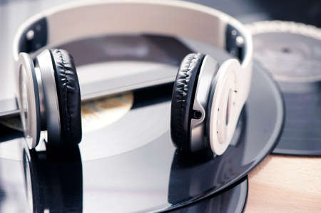 Vinyl record player headphones and tablet. Music concept