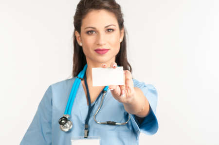 surgical coat: Female doctor holding blank business card with copy space
