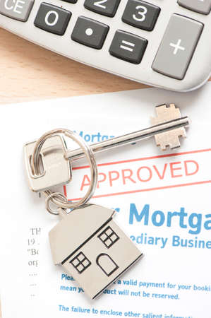 endorsing: Approved Mortgage loan application with house key