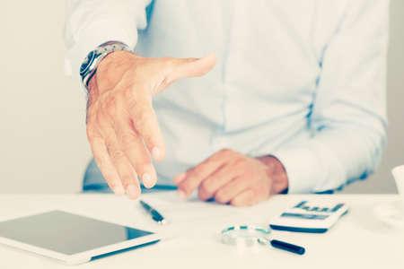 Handshake business: Business man offering handshake Stock Photo