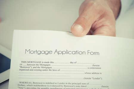 mortgage application: Businessman or salesman handing over a mortgage application