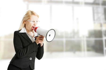 annoucement: Young woman shouting with a megaphone Stock Photo