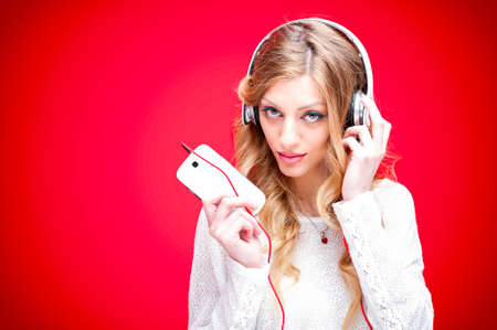 Listening to music on red background