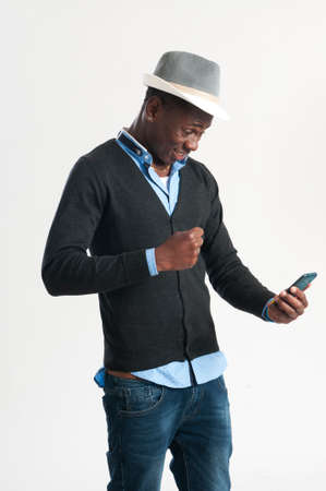 young man using a cell phone, isolated on white