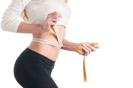waistline: Woman measuring her waistline Perfect Slim Body