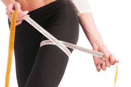 woman measuring: Woman measuring her body. Perfect Slim Body