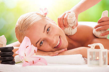 salon and spa: Beautiful Woman Getting Spa Massage in Spa Salon