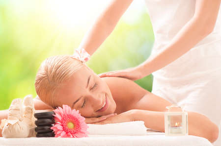 revitalize: Portrait of young beautiful woman in a spa