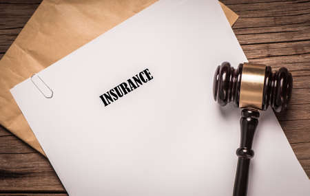 policy document: Insurance Policy document with court gavel Stock Photo