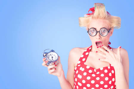 Portrait of a surprised Pin up girl with alarm clock