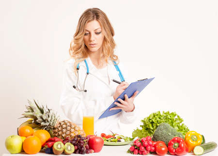 Nutritionist with fresh vegetables and fruits Stock Photo