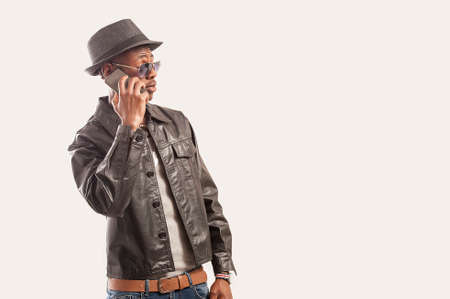 Portrait of young african american guy using a cell phone Foto de archivo