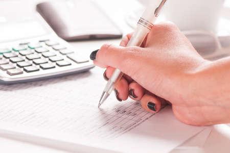 Close up of female accountant 版權商用圖片