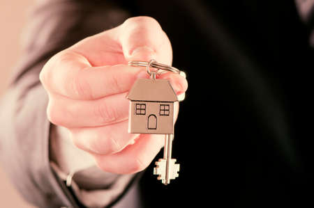 signing authority: Real estate agent handing over house keys