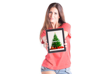 Beuatifull girl holding tablet computer with christmas sale on a screen