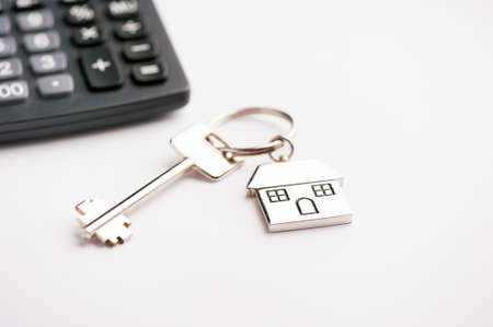 mortgaging: House key and calculator Stock Photo