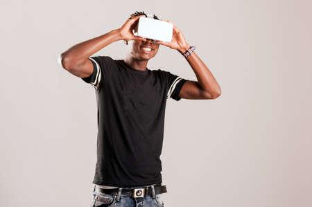 handsfree device: Young man using 3D Virtual Reality Simulator