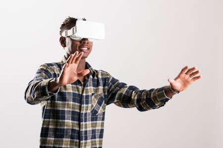 Young man using 3D Virtual Reality Simulator