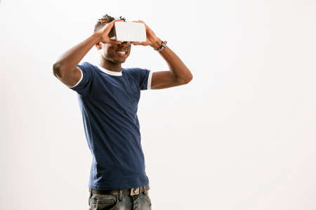 box size: Young man using 3D Virtual Reality Simulator
