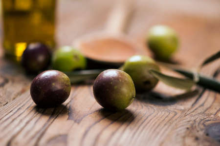 vitamines: olives on wooden table Stock Photo