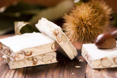 traditon: Delicious Italian festive torrone or nougat on wooden table