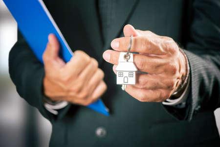 handing over: Real estate agent handing over house keys