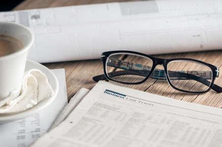Glasses and newspapaer