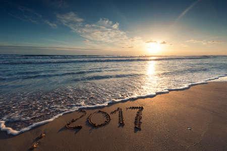 2017 written on sandy beach Standard-Bild