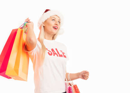 boxing day: Portrait of a young smiling woman with shopping bags Stock Photo