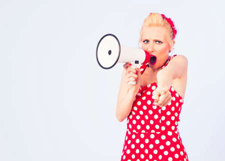 Pin up girl shouting via megaphone
