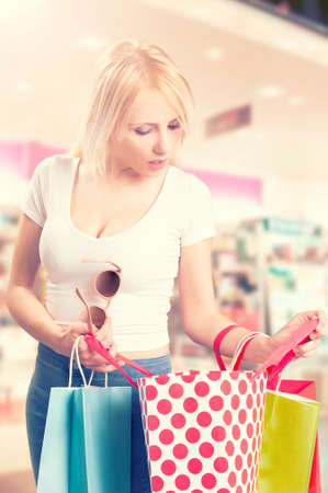 Young  girl with shopping bags at shopping mall
