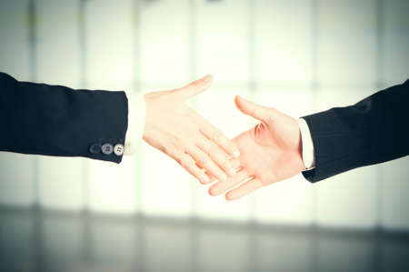 Close-up image of a firm handshake standing for a trusted partnership