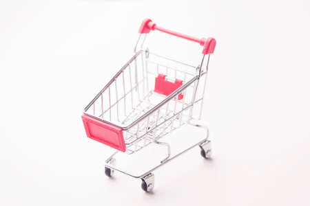Shopping cart against the white background Stock Photo