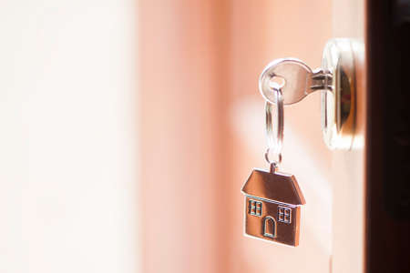 owning: House key in the door