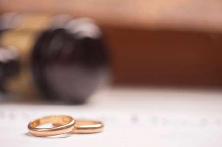 wedding rings with gavel Stock Photo