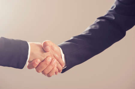 handshake of business partners after signing contract Stock Photo