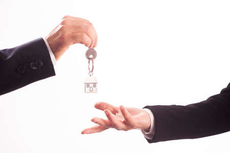 Handling house key. Key, Moving House, Real Estate concept Stock Photo