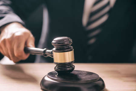 gavel in the hand of a man in a business suit Stok Fotoğraf