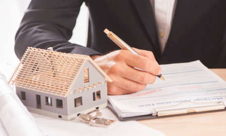 autograph: Businessman signing a mortgage  contract  of a sale for a new house Stock Photo