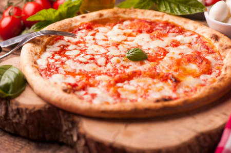 Italian Pizza on rustic wooden table