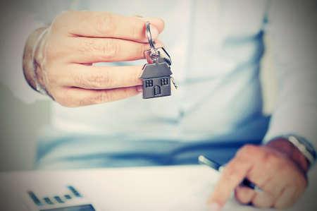 Hand with a house key