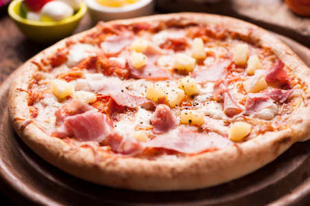 marinara sauce: Wood Fired Gourmet pizza with a topping of Ham and Pineapple