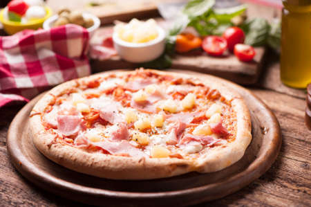 Wood Fired Gourmet pizza with a topping of Ham and Pineapple