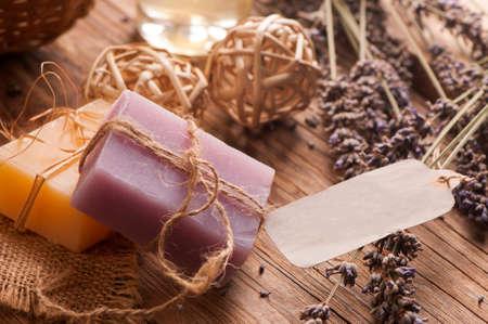 ars of homemade soaps, dry lavender flowers on wooden table Reklamní fotografie