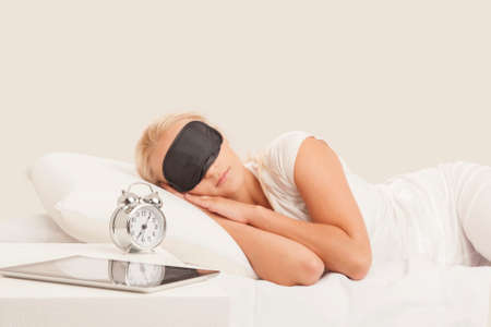 Pretty blonde young woman sleeps in her bed Stock Photo