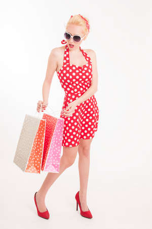 Retro pin up girl shopping. Woman holding paper bag