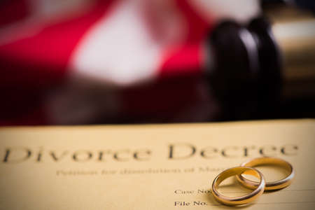 Divorce decree and gavel on a table.